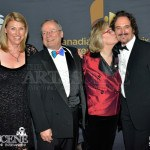 Liberal MP Carolyn Bennett kissing Kim Coates - Canadian Screen Awards 2013